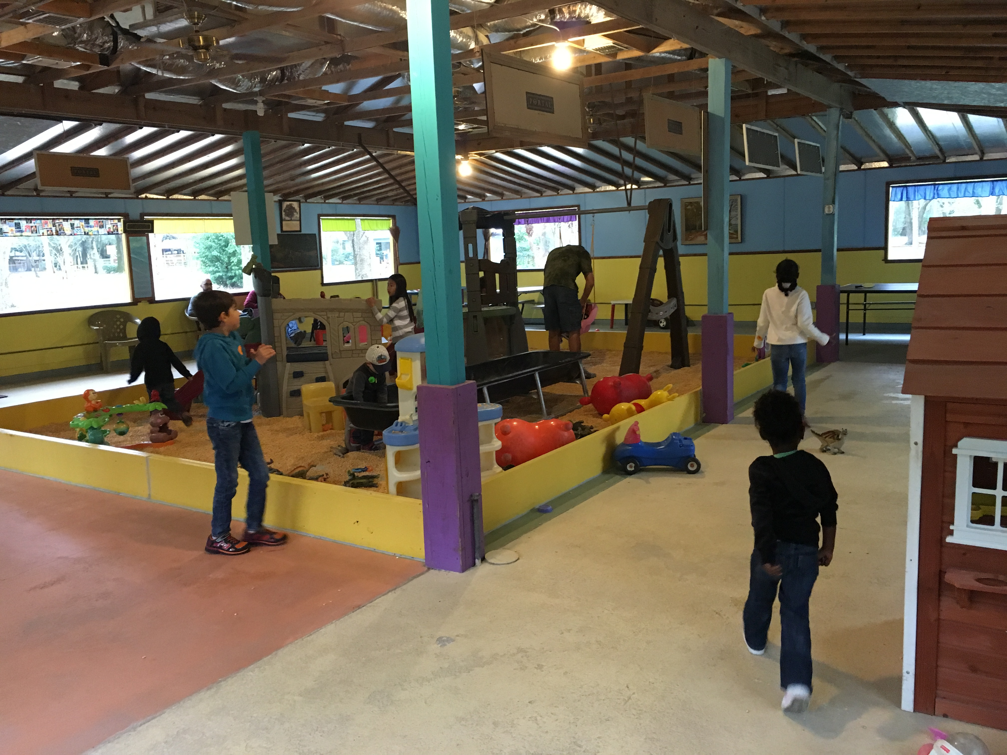 This indoor play ground was ingenious; it had a couple picnic tables and several chairs along the walls for parents to relax and watch their kiddies burn off some energy